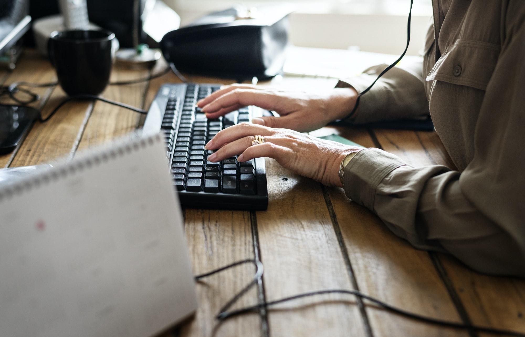 Caucasian woman using computer